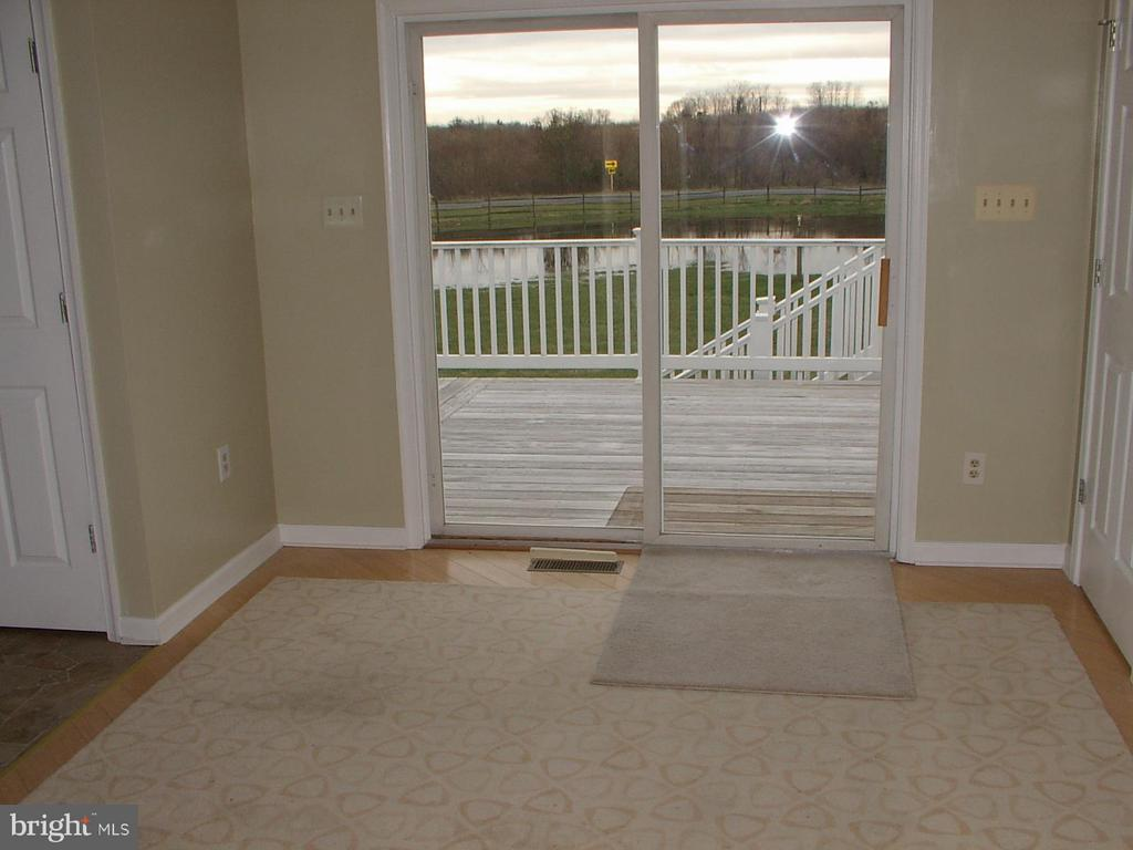 Dining room exit to deck - 1919 WITHERS LARUE RD., BERRYVILLE