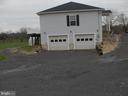 Garage/driveway side view - 1919 WITHERS LARUE RD., BERRYVILLE