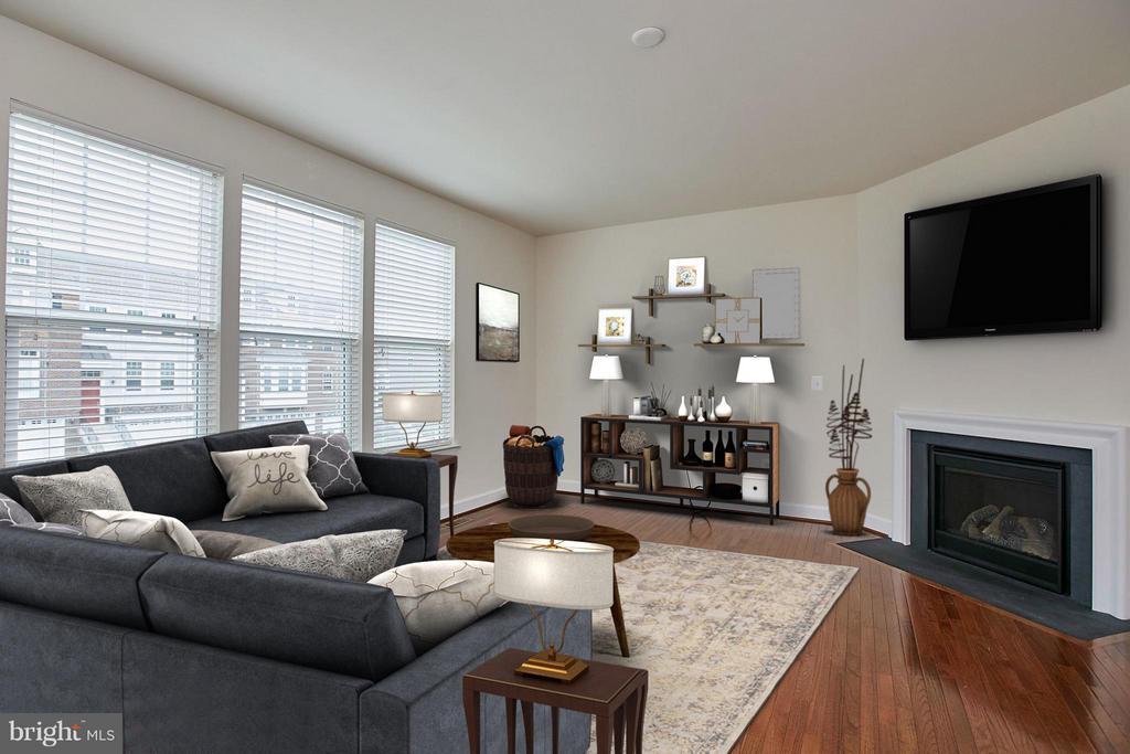 Spacious living room with gas fireplace - 16636 DANRIDGE MANOR DR, WOODBRIDGE