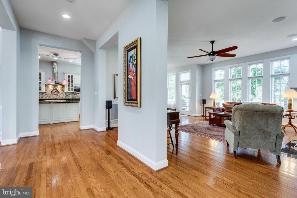 View from the open foyer to great room and kitchen - 18349 MID OCEAN PL, LEESBURG