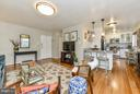 Living room flowing into kitchen - 2710 MACOMB ST NW #216-217, WASHINGTON