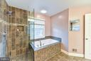 Frameless glass enclosed shower - 1501F N COLONIAL TER, ARLINGTON