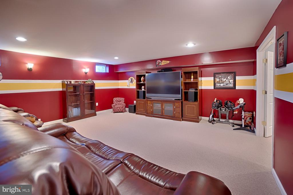 Movie theater room with Redskins colors - 43256 HARPER MANOR CT, ASHBURN