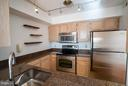 Kitchen opens to the living room - 1200 BRADDOCK PL #705, ALEXANDRIA