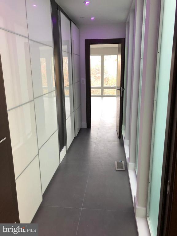 Master closet w/daylight through glass wall - 3722 R ST NW, WASHINGTON