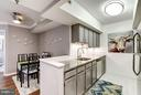 The kitchen overlooks the dining and living area - 2400 CLARENDON BLVD #816, ARLINGTON