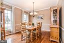 Formal Dining Rm off Kitchen w/ contemp. lighting - 6331 SUMMERDAY CT, BURKE