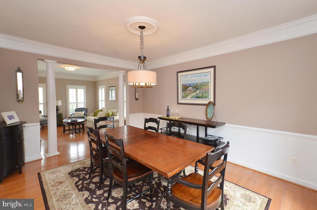 Dining/Living Room with hardwood floors - 18490 ORCHID DR, LEESBURG