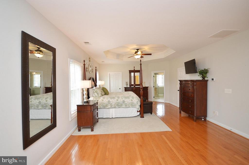 Master Bedroom with hardwood floors - 18490 ORCHID DR, LEESBURG