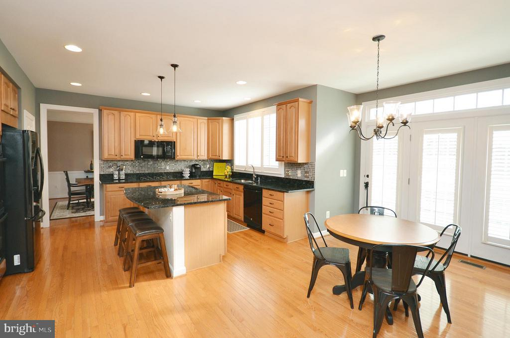 Kitchen has plantation shutters on windows & doors - 18490 ORCHID DR, LEESBURG