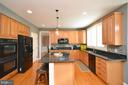 Large Center Island with pendant lights - 18490 ORCHID DR, LEESBURG