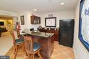 Bar with seating and granite counters - 18490 ORCHID DR, LEESBURG