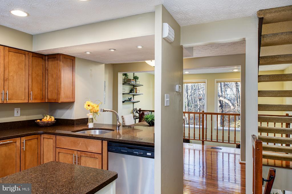 Foyer opens to kitchen - 1652 HARVEST GREEN CT, RESTON