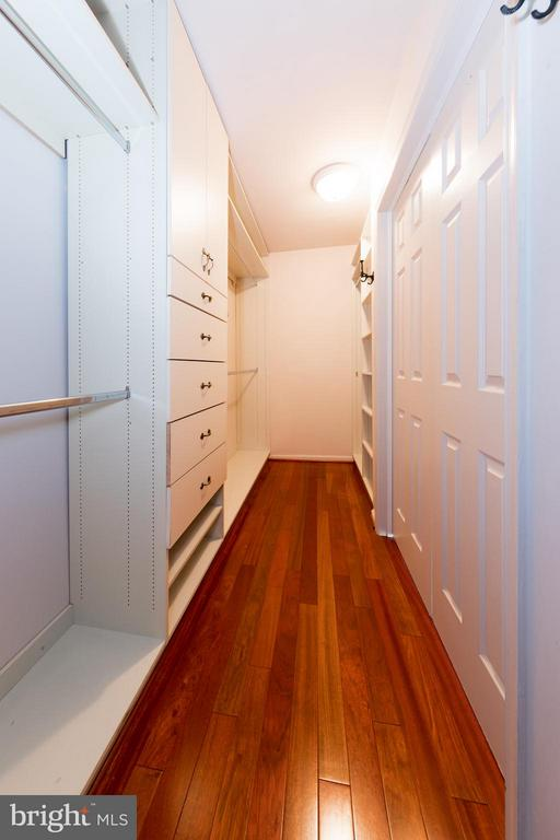 Walk-in closet with cabinetry in master bedroom - 7523 RAMBLING RIDGE DR, FAIRFAX STATION