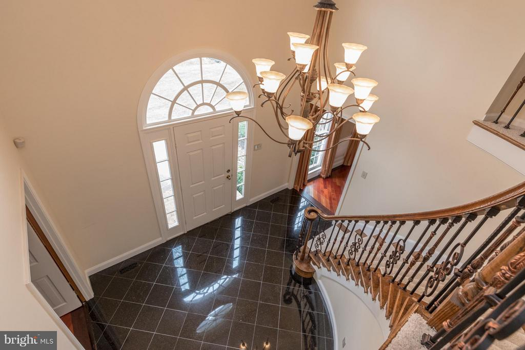 Note the updates railings and custom chandelier - 7523 RAMBLING RIDGE DR, FAIRFAX STATION