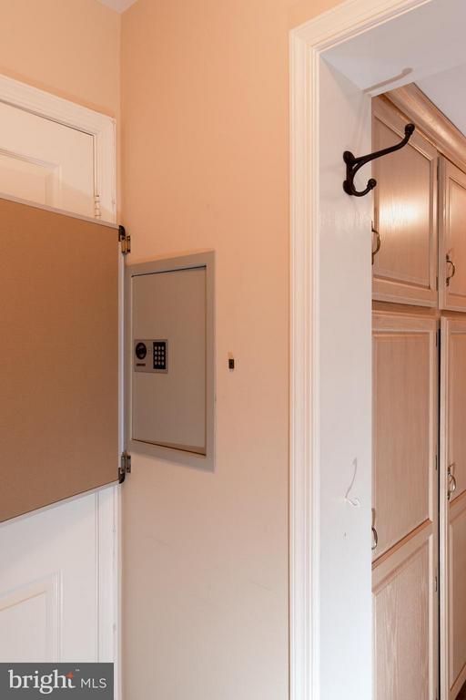 A built-in safe is hidden behind the door. - 7523 RAMBLING RIDGE DR, FAIRFAX STATION