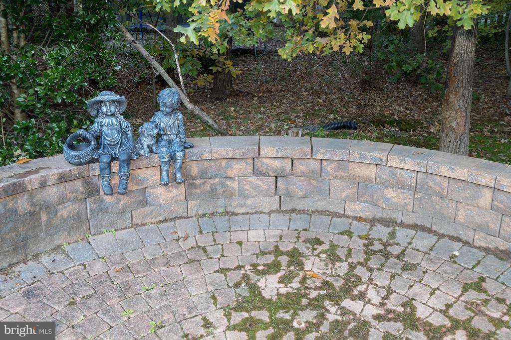 Whimsical figurines enhance this hardscape area... - 7523 RAMBLING RIDGE DR, FAIRFAX STATION