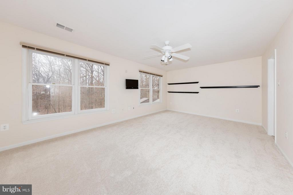Note this bedroom also conveys with a mounted TV - 7523 RAMBLING RIDGE DR, FAIRFAX STATION
