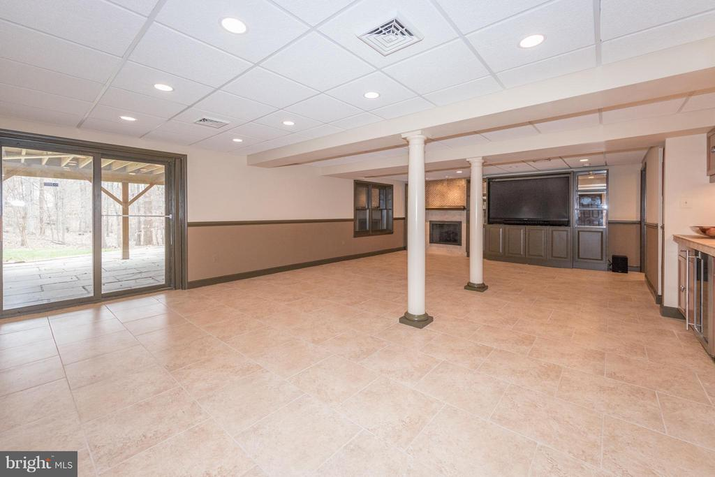 Large recreation room with built-in media! - 7523 RAMBLING RIDGE DR, FAIRFAX STATION