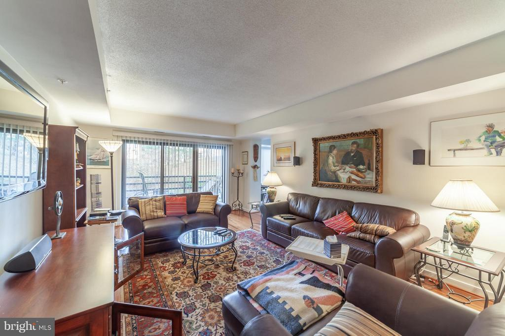 Family room with hardwood floors - 10001 WINDSTREAM DR #207, COLUMBIA