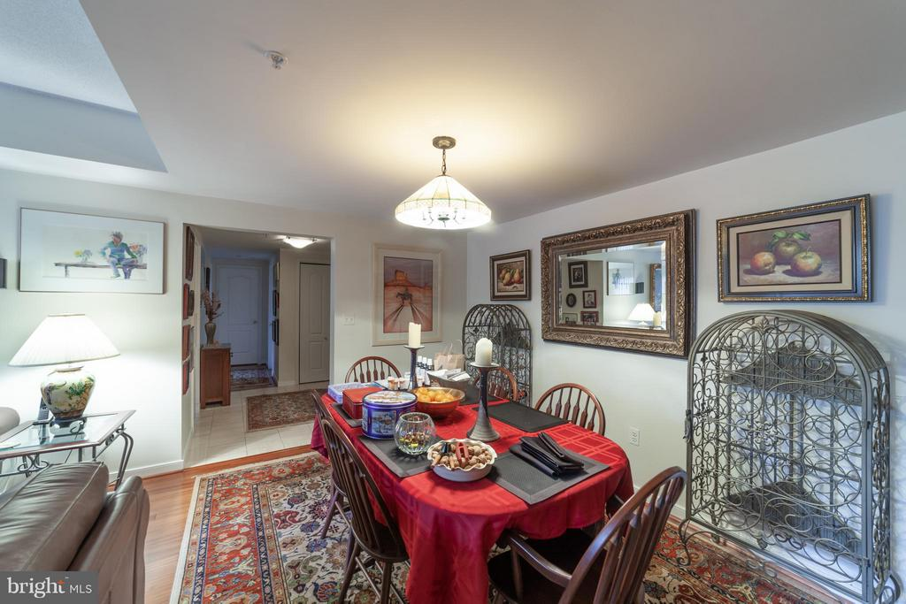 Dining room with lovely wood floors - 10001 WINDSTREAM DR #207, COLUMBIA