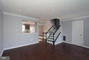 Living/family room with new hardwood florrs - 843 SMARTTS LN NE, LEESBURG