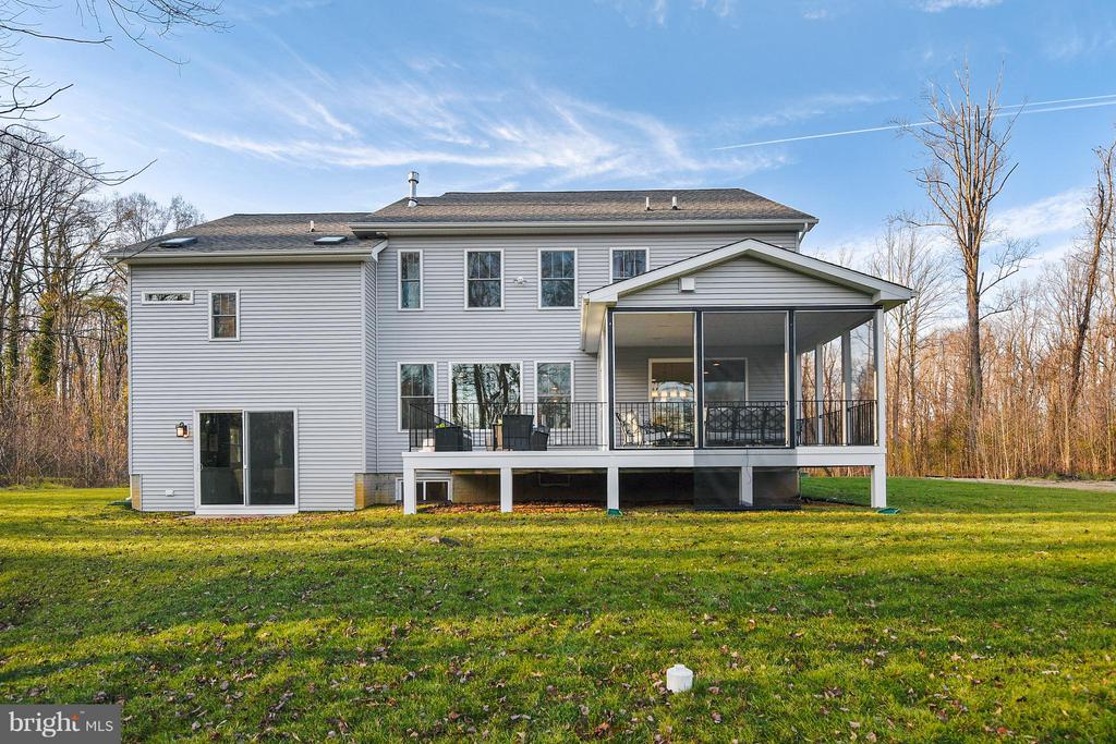 Back of the house with walk out from recreation rm - 299 BONHEUR AVE, GAMBRILLS