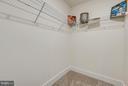 walk in closet to bedroom 2 - 299 BONHEUR AVE, GAMBRILLS