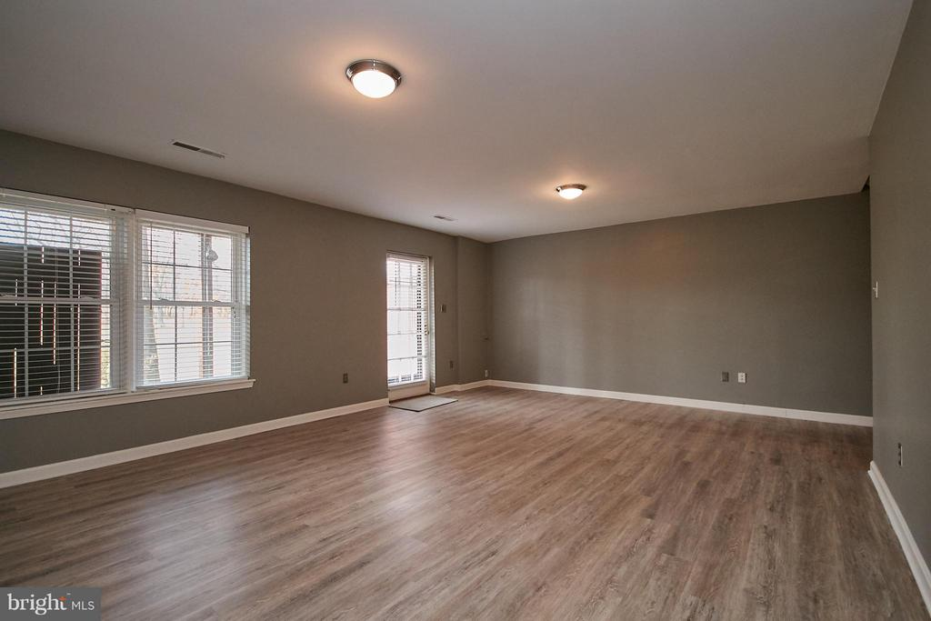 New Luxury Vinyl Plank Flooring in the Rec Room - 2158 GOLF COURSE DR, RESTON