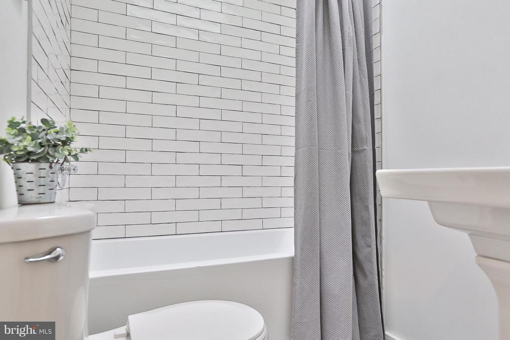 Clean and Chic white tile - 2817 5TH ST NE, WASHINGTON