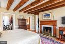 Master Bedroom with Wood burning fireplace - 18483 SILCOTT SPRINGS RD, PURCELLVILLE