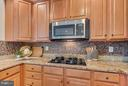 Custom back splash and brand new GE microwave - 3530 CONNOR PL, FREDERICK