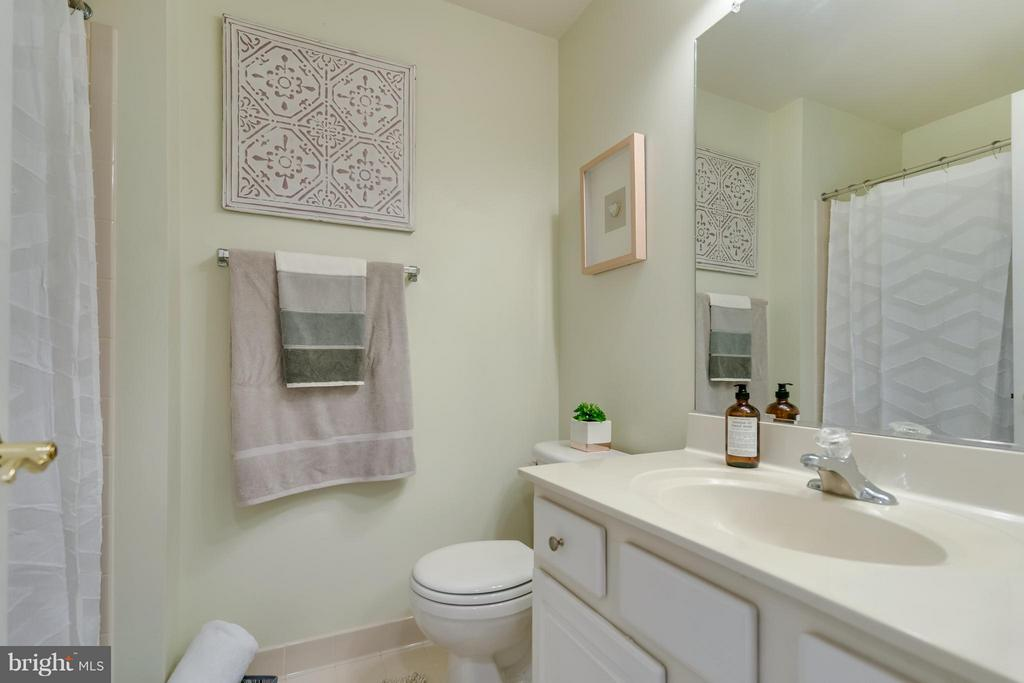 Guest bath is neutral and has large cabinet - 3530 CONNOR PL, FREDERICK