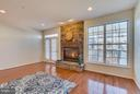 Rustic stone complements modern gas fireplace - 3530 CONNOR PL, FREDERICK