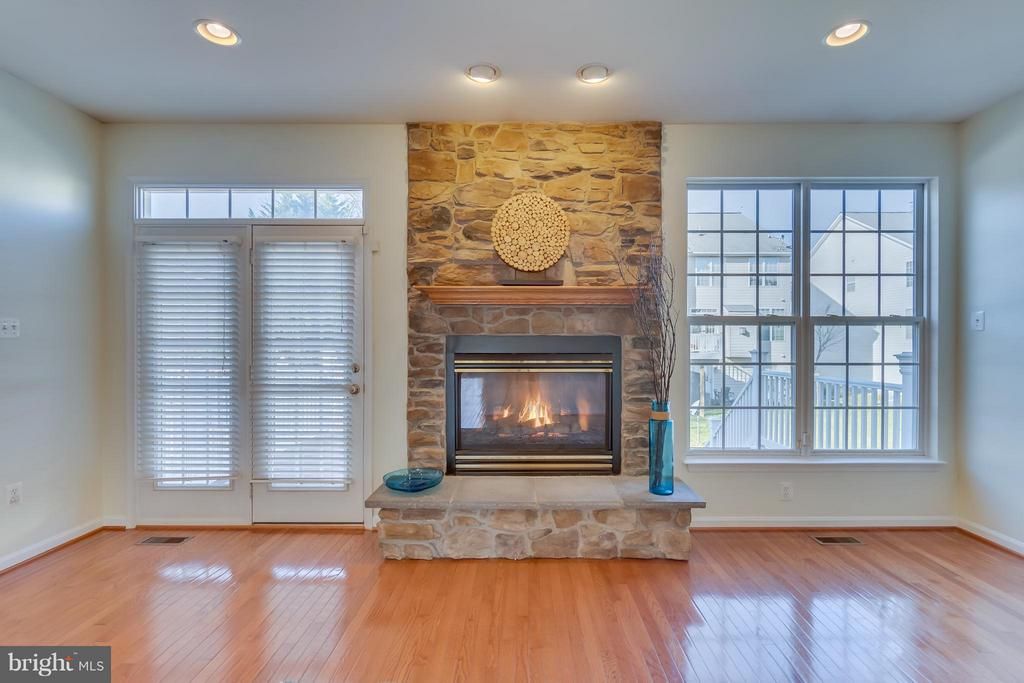 symmetry of light enveloping fireplace, mantel - 3530 CONNOR PL, FREDERICK