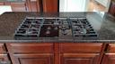 Kitchen Island with Gas Cooktop - 46071 EARLE WALLACE CIR, STERLING