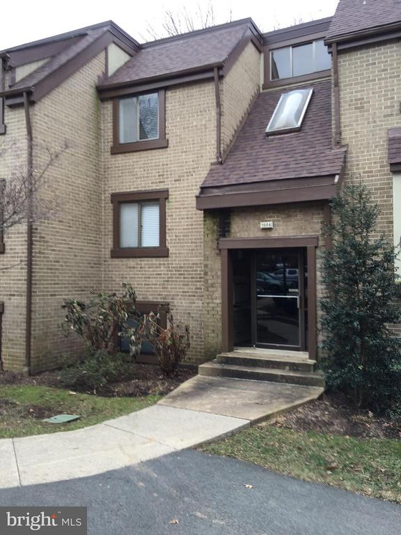 Front of home! Indoor stairs--1.5 levels up. - 1664 PARKCREST CIR #300, RESTON