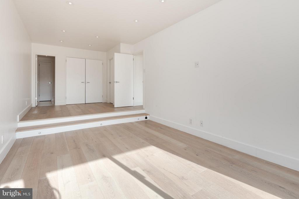 Bedroom with desk space and custom ready closets - 2501 M ST NW #608, WASHINGTON