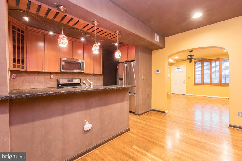 Kitchen with Stainless Steel Appliances and Bar - 1607 FAIRLAWN AVE SE, WASHINGTON