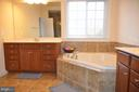 CERAMIC TILE FLOORING AND CORNER TUB - 15106 ADDISON LN, WOODBRIDGE