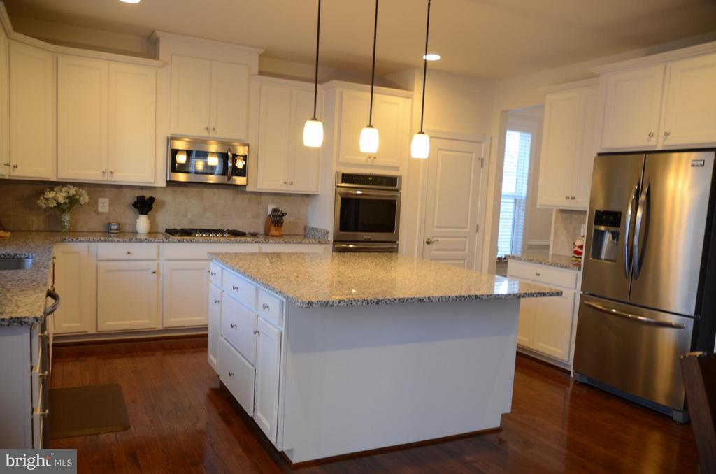 ONE OF THE LARGEST KITCHEN ISLAND'S YOU WILL SEE - 15106 ADDISON LN, WOODBRIDGE