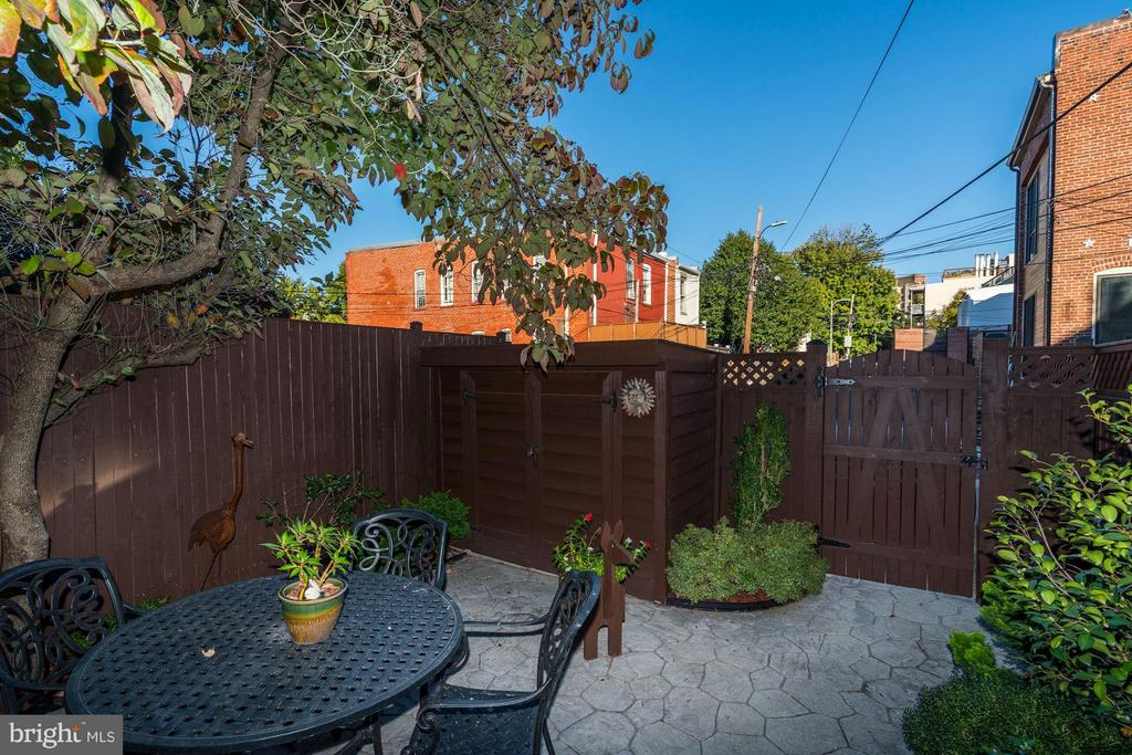 Rear patio with shed leading to parking - 1309 22ND ST NW, WASHINGTON