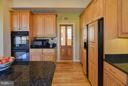Kitchen leads to main level laundry! - 38814 BOCA CT, WATERFORD