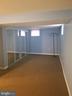 Bonus room w/ large closet and sliding mirror door - 9203 ALCONA ST, LANHAM
