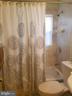 Main Level bath - 9203 ALCONA ST, LANHAM