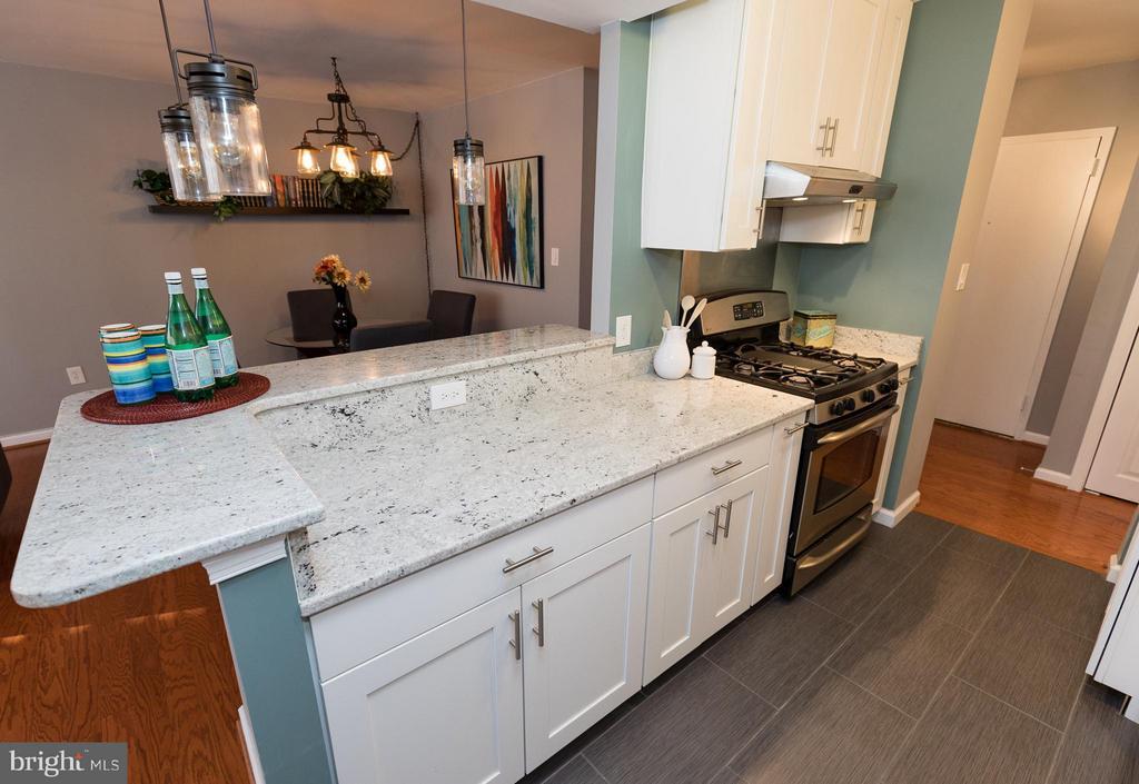 Kitchen with breakfast bar - 2030 F ST NW #201, WASHINGTON