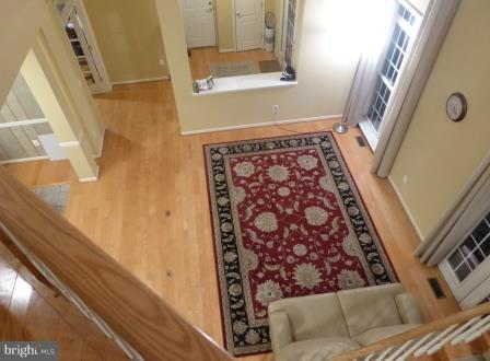 Two-Story Family Room  Overlooks  Enclosed Patio. - 21844 WESTDALE CT, BROADLANDS