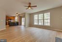 Family Room has new wood flooring & lots of light - 15333 TINA LN, WOODBRIDGE