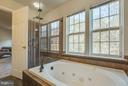 Jacuzzi tub with natural light from large windows - 15333 TINA LN, WOODBRIDGE
