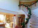 Entry way with curved stair and pillar to living - 42596 IRON BIT PL, CHANTILLY